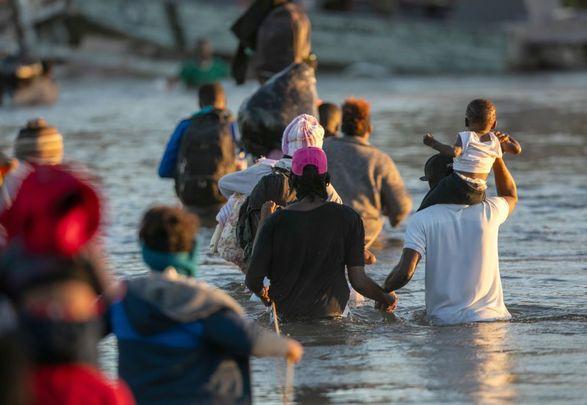 Haitian immigrant families cross the Rio Grande into Del Rio, Texas on September 23, 2021, from Ciudad Acuna, Mexico
