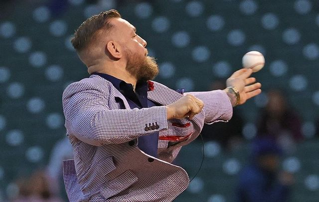 September 21, 2021: Conor McGregor throws out a ceremonial first pitch before the Chicago Cubs take on the Minnesota Twins at Wrigley Field in Chicago, Illinois.