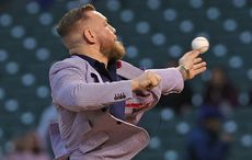 WATCH: Conor McGregor can throw a punch, but not a pitch