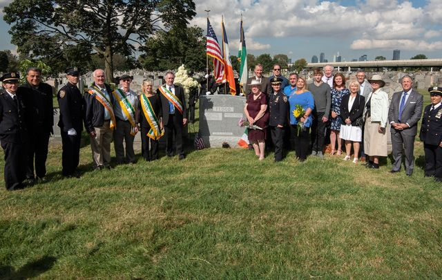 A ceremony at Calvary Cemetery in Woodside, Queens in honor of Patrolman John P. Flood, a County Cavan-born NYPD member who was beaten to death in the line of duty.