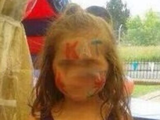"""Kill All Taigs"" painted on several children's faces at Eleventh night bonfire party."