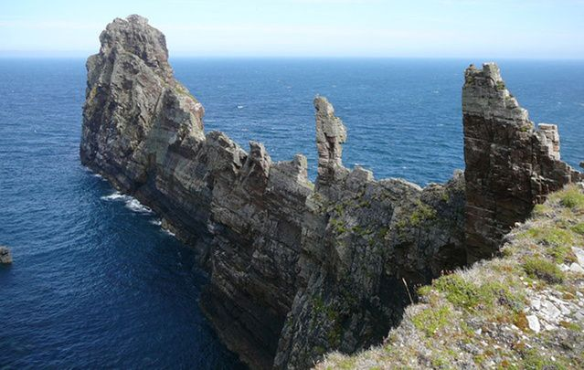 This spectacular blade of rock thrusts out into the Atlantic at the north eastern corner of Tory Island and reaches almost 80 metres high.