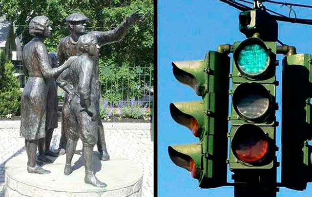 "The Stone Throwers, an Irish memorial statues and the ""Green over Red\"" traffic light."