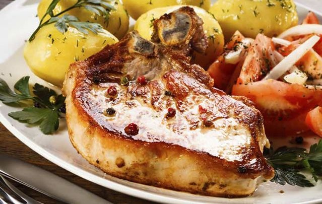 Pork Chops with Guinness and Onion Gravy is delicious paired with vegetables and roasted potatoes.