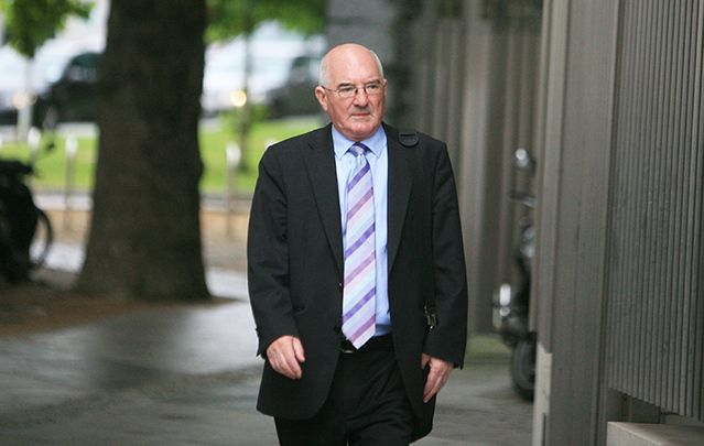 Former Anglo Irish Bank executive Willie McAteer on his way into court this morning.