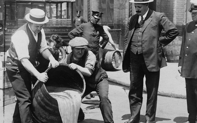Officials dispose of liquor during the Prohibition era in the US.