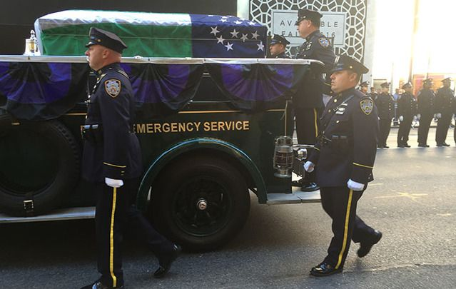 Police line Fifth Avenue to pay respects to John Timoney on Tuesday morning.
