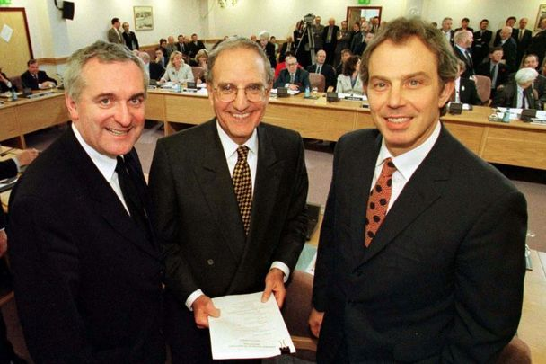 Taoiseach Bertie Ahern, Senator George Mitchell and British Prime Minister Tony Blair at Castle Buildings after they signed the Good Friday Agreement in 1998.