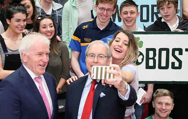 Ireland's Minister for the Diaspora Jimmy Deenihan and the US Ambassador to Ireland Kevin O'Malley take a self with this year\'s J-1 students at UCD.