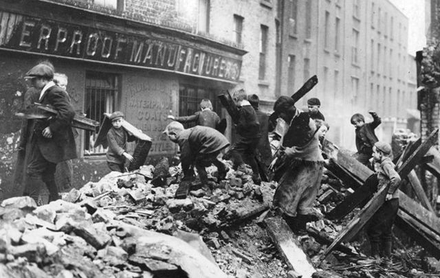 Poor children of Dublin collecting firewood from the ruined buildings damaged in the Easter Rising.