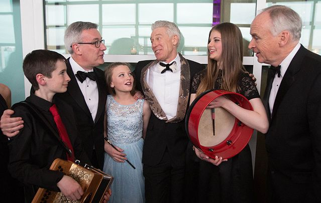Young musicians from Music Generation speak with Kieran McLoughlin, president and CEO of The Worldwide Ireland Funds, Adam Clayton of U2, and John Fitzpatrick, chairman of The American Ireland Fund, d