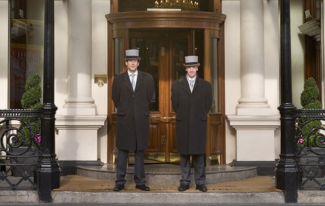 Doormen at the iconic Shelbourne Hotel, in Dublin: American, Canadian and UK folks are loving Irish luxury vacations this year!
