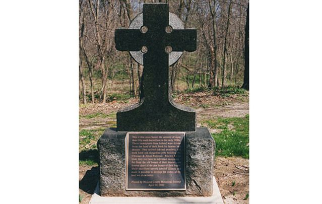 Many people have heard of the Irish rail workers mass grave in Duffy's Cut, PA, but few know about Funks Grove, IL. Above: The Celtic cross installed there in 2000.