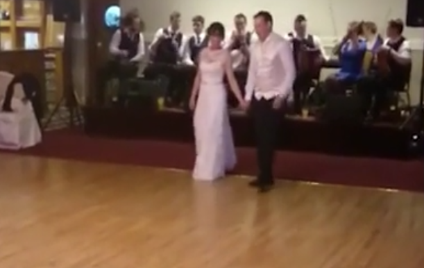 Snapshot of wedding dance video of Aoife Neville and Seán Longe, who surprised guests at their wedding with a lively Irish step dance.