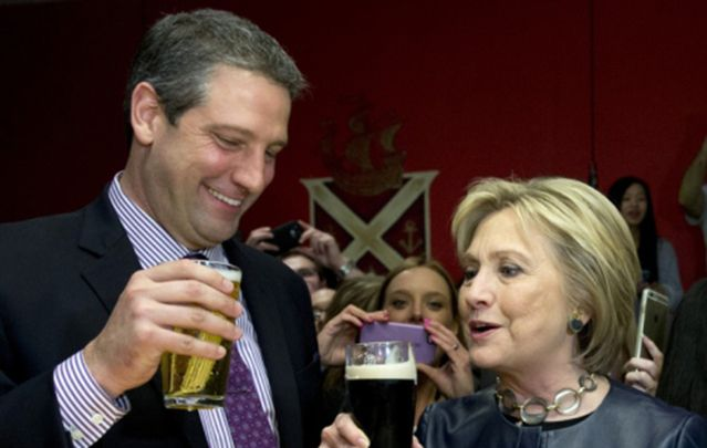 Rep. Tim Ryan (D-Ohio) and Hillary Clinton have a beer March 12 in a packed O'Donold's Irish Pub and Grill in Youngstown, Ohio.