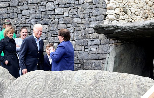 Vice President Joe Biden is given a tour by the local historian Claire Tuffy on his visit to Newgrange, in County Meath, morning his family.