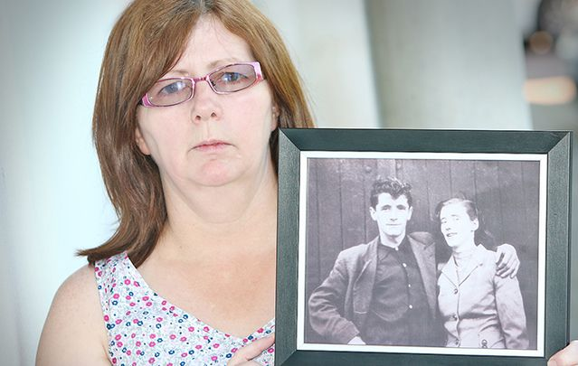 Janet Donnelly with a photo of her mother and father, Mary Ellen and Joseph Murphy.