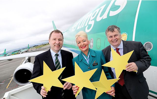 CEO Stephen Kavanagh, Cabin Crew Tracy Johannson and Chief Operating Officer Mike Rutter celebrate the news that Aer Lingus announce has achieved a four-star rating by Skytrax, the international air t