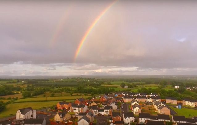 A shot from Martin McKenna's YouTube video showing a rainbow above Maghera, Northern Ireland.
