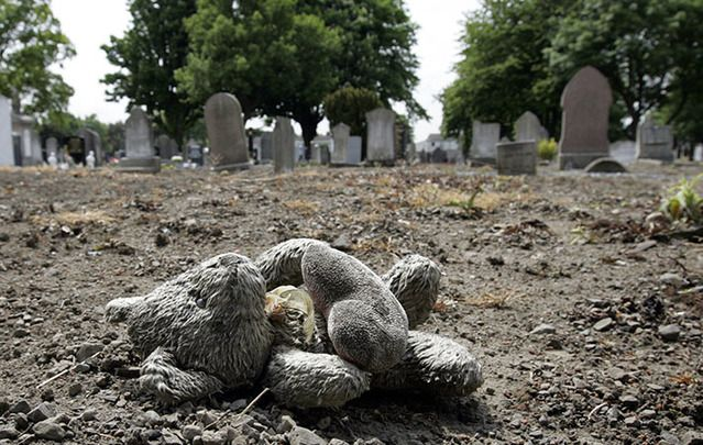 A child's teddy bear marks the spot where the unmarked graves of 40 children from a Protestant residential institution, Bethany House, were discovered in Mount Jerome Cemetery in Dublin.
