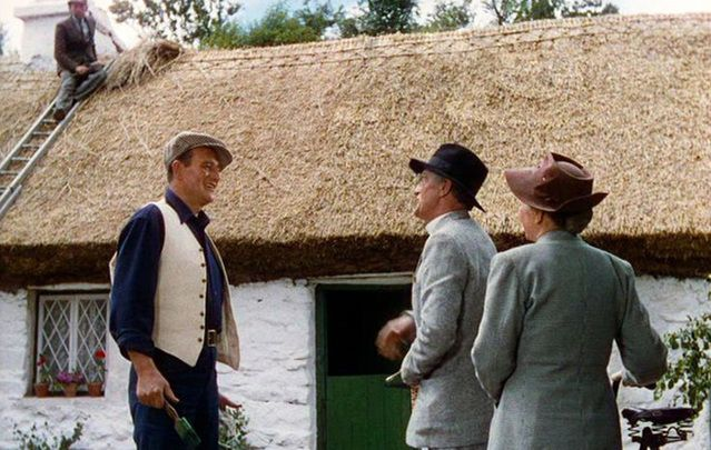 Still of John Wayne and the White O'Morn cottage, in County Galway, from The Quiet Man.