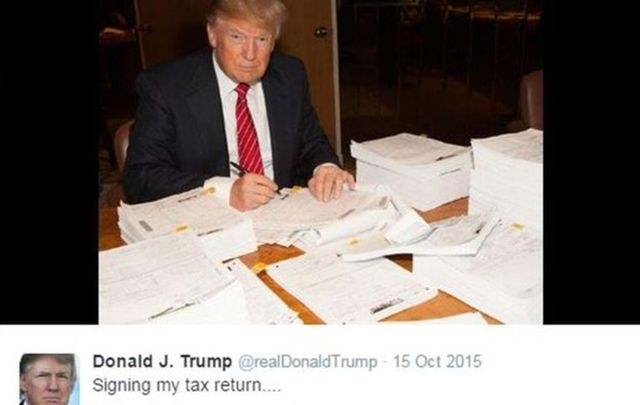 Donald Trump with his 2015 tax returns.