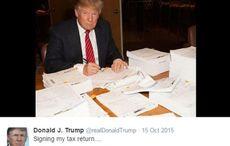 Thumb_main-trump-signing-his-tax-returns-twitter