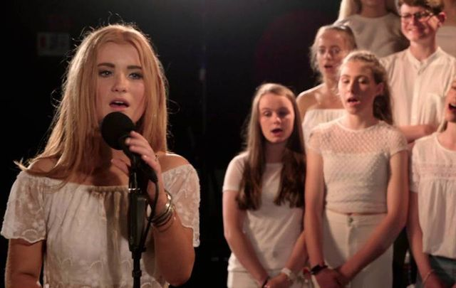 "Shannon Bryan and a choir of Colaiste Lurgan student sing Adele's ""Hello."""