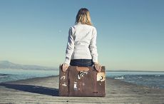 Thumb_mi_woman_suitcase_coast_pier_emigrant_immigration_travel_istock