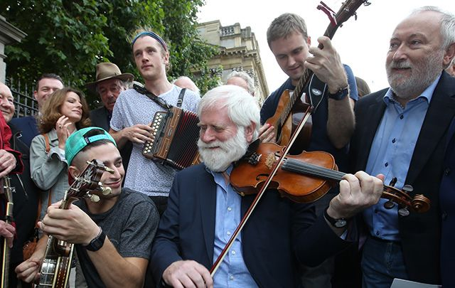 Pictured (Ltor) Band Moxie play with singer/song writers Phil Coulter and John Sheahan joined musicians to play irish music outside Leinster House.
