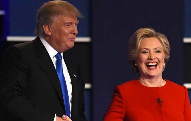 Democratic nominee Hillary Clinton (R) shakes hands with Republican nominee Donald Trump after the first presidential debate at Hofstra University in Hempstead, New York on September 26.