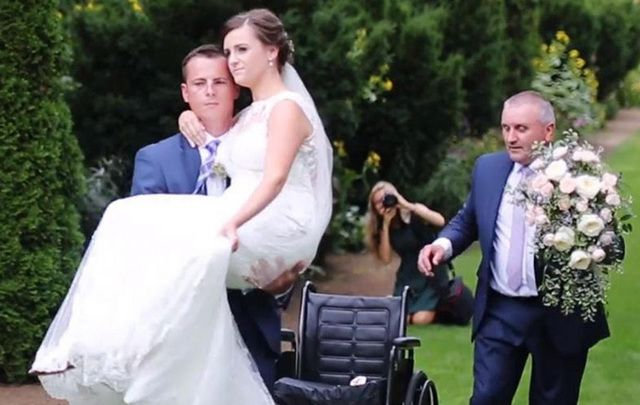 Stuart Patterson, carrying his bride, Hannah up the aisle just weeks after she broke her pelvis in a car crash.