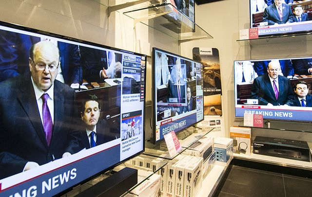 Finance Minister Michael Noonan on TV screens in Arnotts department store in Dublin delivering the budget on Tuesday.