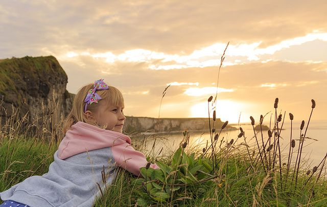 A little girl enjoying the view along the Antrim Coastal Drive.
