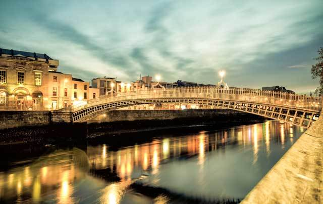 The Ha\' Penny Bridge, on the River Liffey, in Dublin.