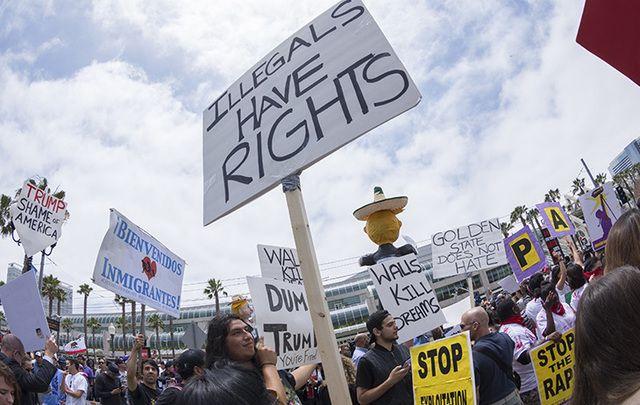 Protestor's hold pro-immigration reform poster aloft.