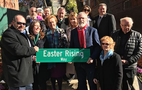 Local dignitaries and Irish figures gather for a photo with the renamed street sign