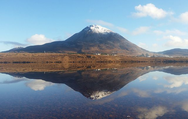 All is still and calm. Dunlewey Lake, in County Donegal with the Errigal Mountains in the background.