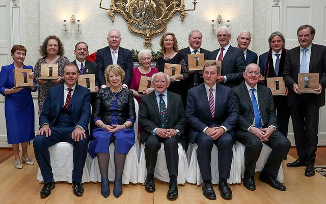 Presidential Distinguished Service Award for the Irish Abroad: Sr. Mary Sweeney, Kathleen Walsh D'Arcy, Brendan Fay, Nora Higgins, Angela Brady, Brian Wogan, Gerard Lawless, Norman McClellan, Martin von Hildebrand Mulch and Garret Fitzgerald. Front: Joe McHugh, Minister of State for the Diaspora and Overseas Development Aid, Sabina Higgins, President Michael D. Higgins, Taoiseach Enda Kenny and Charlie Flanagan, Minister for Foreign Affairs and Trade.