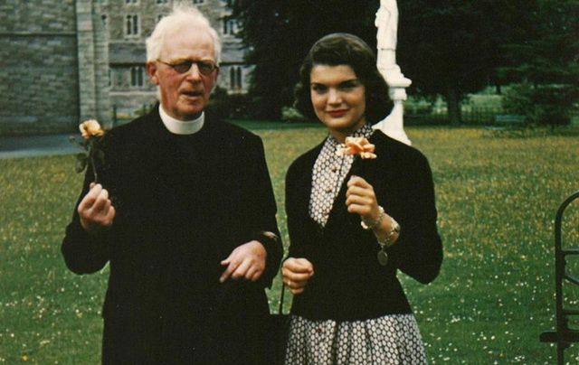 Father Joseph Leonard and Jackie Kennedy.
