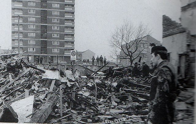 A British soldier surveys the aftermath of the bombing at McGurk\'s Bar in Belfast in December 1971.
