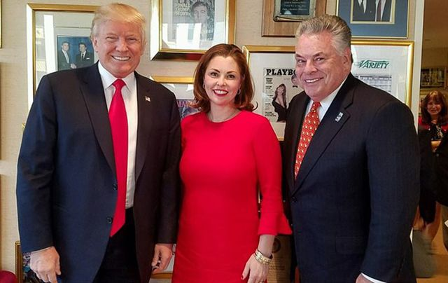 Donald Trump, Erin King Sweeney and her father, Pete King at Trump Tower, Manhattan.