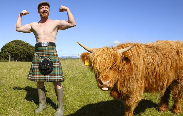 Irish naked farmer hanging with a cow.