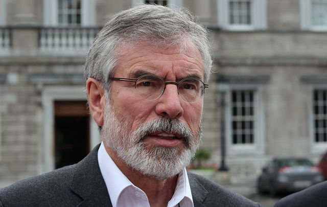 Sinn Fein leader Gerry Adams warns about the imminent collapse of the Northern Ireland power sharing government due to Arlene Foster's refusal to step down amidst scandal.