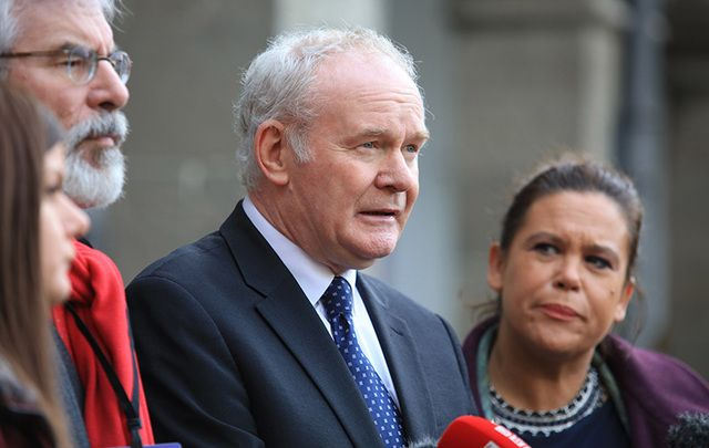 Sinn Fein\'s Martin McGuinness, flanked by Gerry Adams and Mary Lou McDonald outside the Dail, in Dublin.