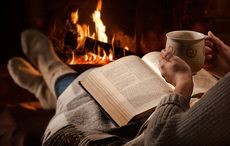 Thumb reading by the fire books istock
