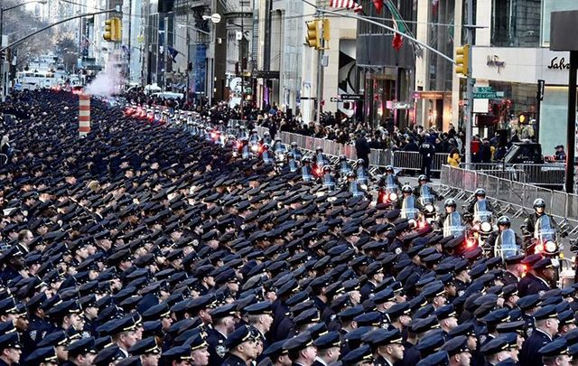 Thousands of police officers lining Fifth Ave this morning.