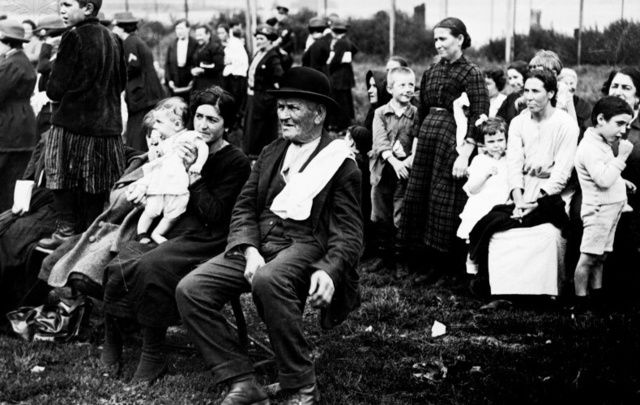 Immigrants wait their turn at Ellis Island, New York.
