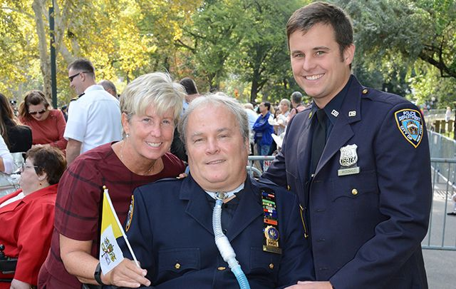 NYPD Detective Steven McDonald, with his wife Patti-Ann and son Conor, march in the 2014 St. Patrick's Day parade.