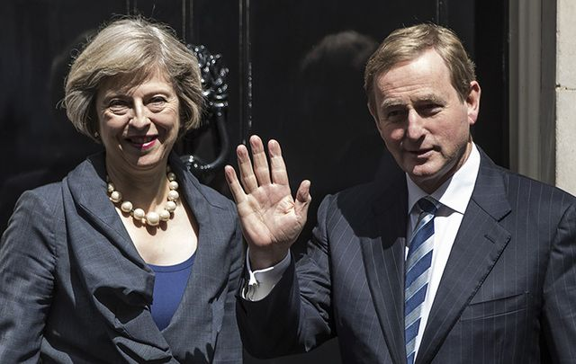 British Prime Minister Theresa May and Taoiseach Enda Kenny stand outside 10 Downing Street.